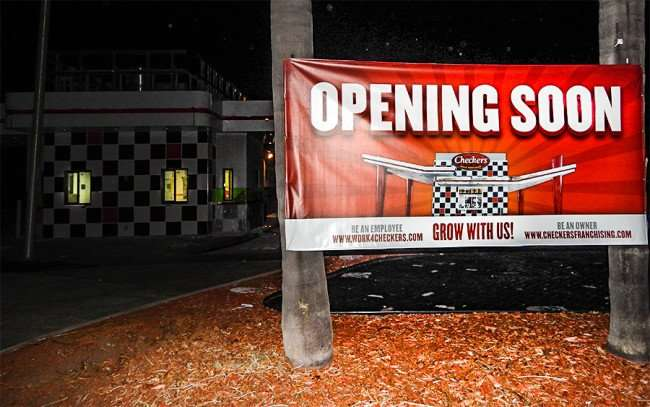 OCT 14, 2015 - Checkers Hamburger Restaurant banner reads OPENING SOON in Sun City Center, FL/photonews247.com