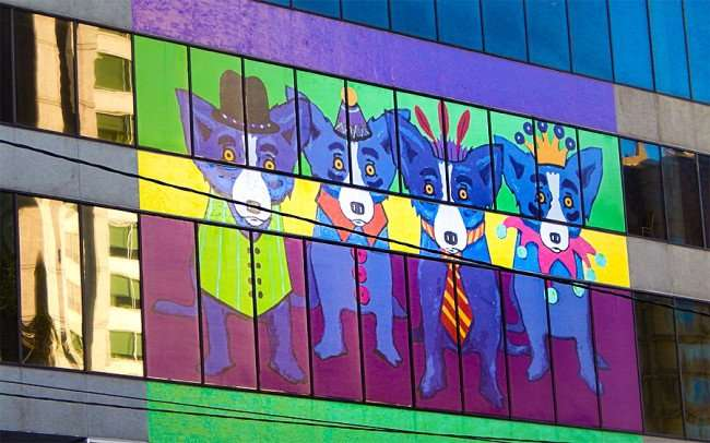 SEPT 13, 2015 - Colorful puppy dog mural on glass Sheraton New Orleans Hotel facing Canal Street/photonews247.com