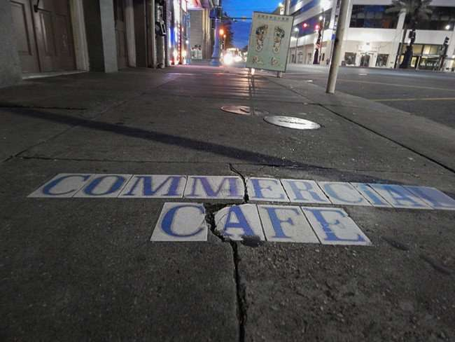 NOV 19, 2015 - Commercial Cafe embedded with tiles on sidewalk in New Orleans, LA/photonews247.com