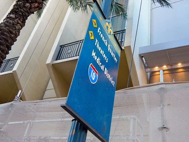 SEPT 13, 2015 - Directional street banners with arrows to French Quarter, Theaters, Medical District and Hwy 10 on Canal Street, New Orleans/photonews247.com