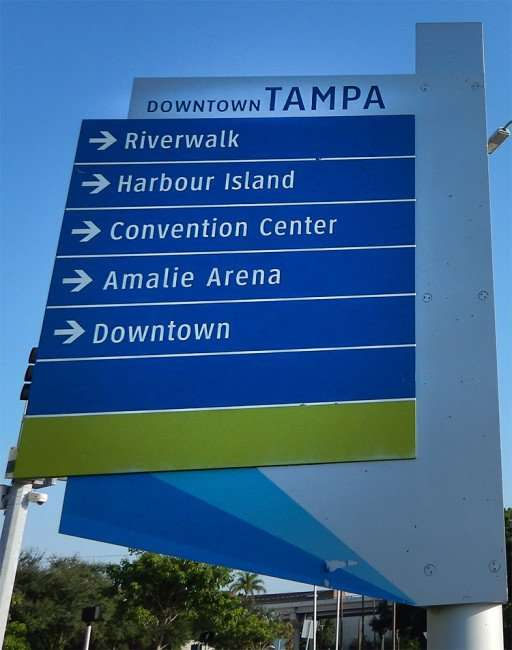AUG 23, 2015 - Downtown Tampa direction sign pointing to Harbour Island, Riverwalk, Amaile Arena, Riverwalk and the Tampa Convention Center TCC/photonews247.com