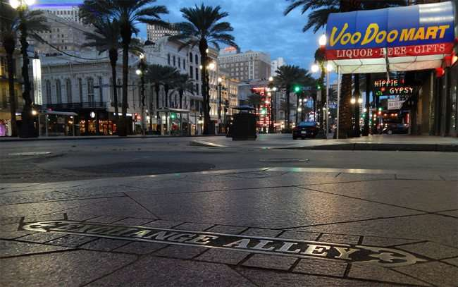 NOV 19, 2015 - Exchange Alley Street name embedded in sidewalk by VooDoo Mart along Canal Street, New Orleans, LA/photonews247.com