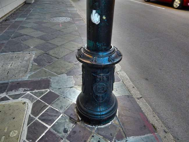SEPT 13, 2015 - Finger sticker on light pole with Saints icons in New Orleans, LA/photonews247.com
