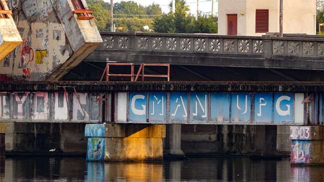 AUG 23, 2015 - Graffiti Man Up on CSX Train bridge along Cass Street Bridge, Tampa, FL/photonews247.com