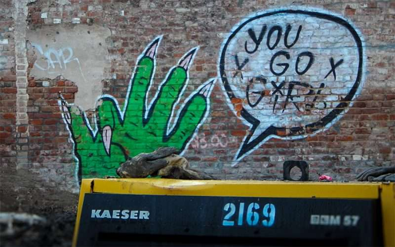 NOV 19, 2015 - Graffiti green hand with pointed nails with 'You Go Girl' on building along Canal Street, New Orleans, LA/photonews247.com