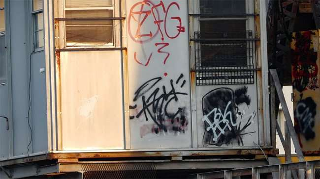 AUG 23, 2015 - Graffiti painted on Cass Street CSX Train bridge, Tampa, FL/photonews247.com