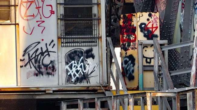 AUG 23, 2015 - Graffiti painted on cabin on the Cass Street CSX Train bridge, Tampa, FL/photonews247.com