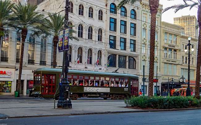 SEPT, 13, 2015 - The Saint Charles streetcar is the green car and is one of the country's only mobile national monuments. The St Charles car has open windows and was filled with passengers on a Sunday (Sept 13, 2015) on Canal Street in New Orleans, LA/photonews247.com