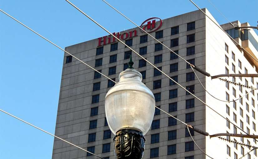 SEPT 13, 2015 - Hilton Hotel New Orleans in back of street light and electric wires/photonews247.com