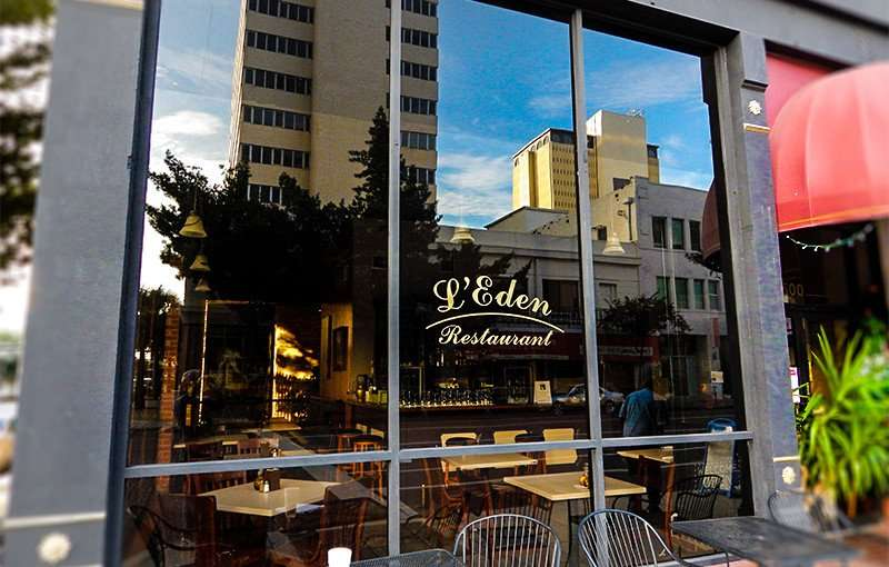 NOV 8, 2015 - L'Eden Restaurant front window with tables on sidewalk along Tampa Street/photonews247.com