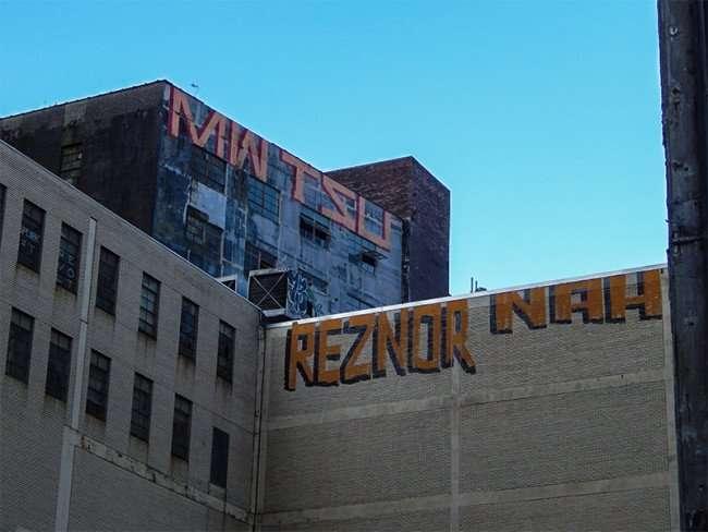 NOV 19, 2015 - MWTXU and REZNOR NAH Graffiti painted on tops of buildings next to Pythian construction site, New Orleans, LA/photonews247.com