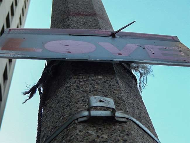 NOV 19, 2015 - Makeshift sign that reads LOVE on street pole on S Rampart St, New Orleans, LA/photonews247.com