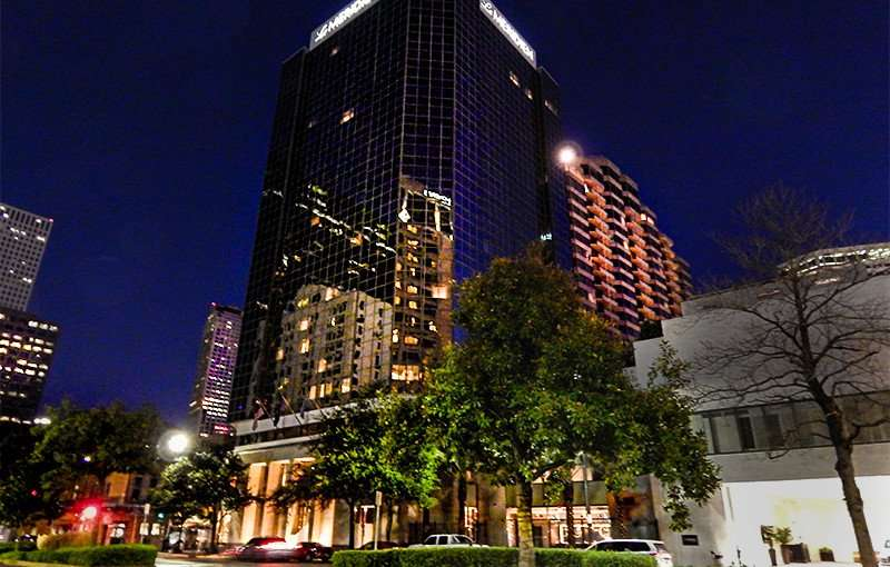 SEPT 13, 2015 - Le Meridien Hotel building at night from Poydras Street reflecting buildings on glass that spans 23 floors in New Orleans, LA/photonews247.com
