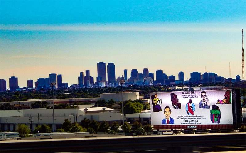 SEP 13, 2015 - New Orleans Skyline with inspirational billboard that reads 'Black Men Stand UP and Take Your Rightful Place'/photonews247.com