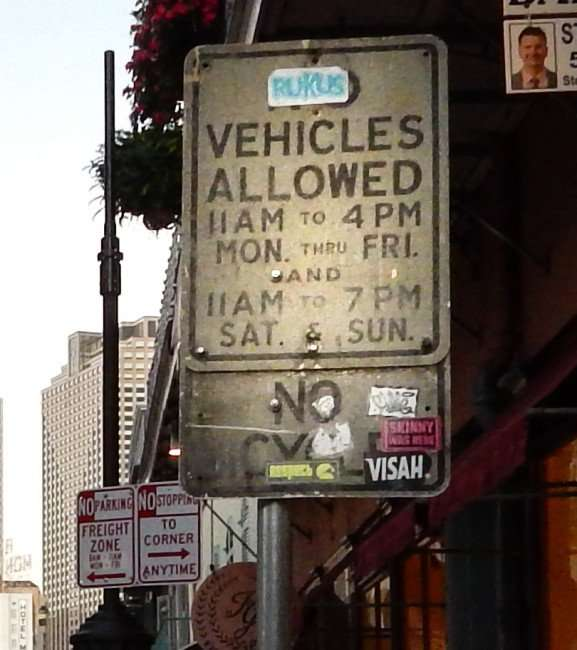 SEPT 14, 2015 - No Vehicles Allow sign covered with decals on Royal Street, French Quarter, New Orleans, LA/photonews247.com