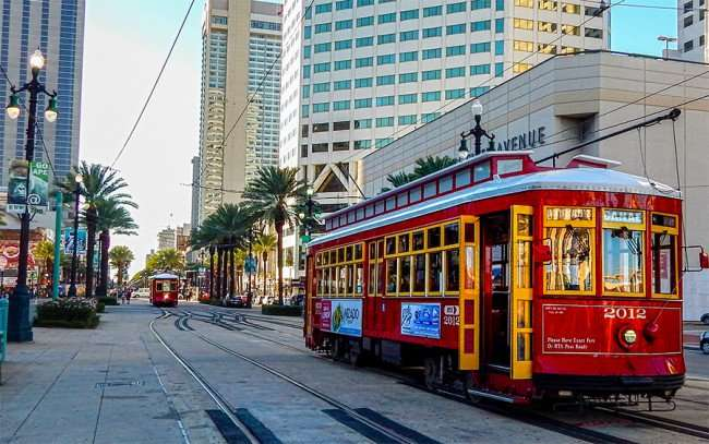 SEPT 13, 2015 - Red Streetcars on Canal Street in New Orleans with clear windows/photonews247.com