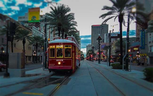 NOV 19, 2015 - Red streetcar 2018 traveling north on Canal Street towards Four Seasons at the Mississippi, New Orleans, LA/photonews247.com