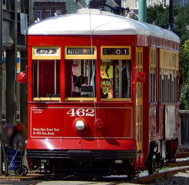 SEPT 14, 2015 - Riverfront Streetcar 462 at stop picking up passenger on Canal St, New Orleans, LA/photonews247.com