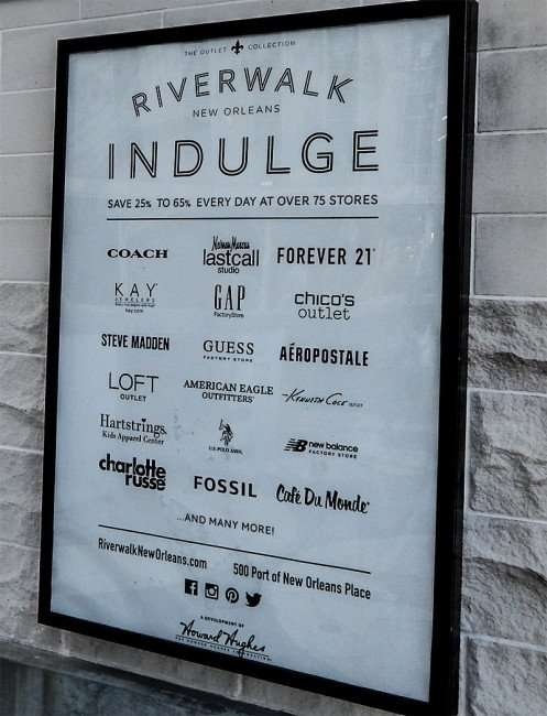 SEPT 14, 2015 Riverwalk Outlet Mall has over 75 stores with 18 listed on sign at Rivewalk New Orleans entrance/photonews247.com