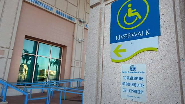 AUG 23, 2015 - Riverwalk sign on pointing section of path the runs behind Tampa Convention Center/photonews247.com