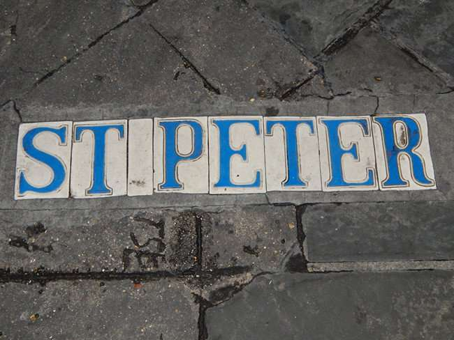OCT 14, 2015 - ST PETER street name embedded in tiles in sidewalk in French Quarter, New Orleans, LA/photonews247.com