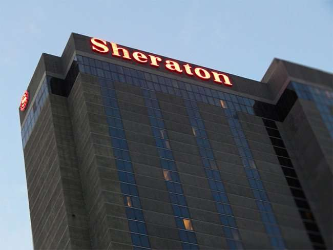 NOV 19, 2015 - Sheraton New Orleans Hotel with name and logo lighted at top of building from Canal Street/photonews247.com