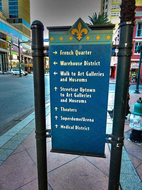 SEPT 13, 2015 - Sidewalk signs labeled with attractions with arrows making navagating around New Orleans easy/photonews247.com