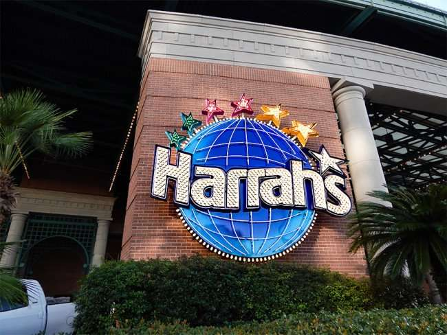 SEPT 13, 2015 - Sign for Harrahs Casino with 7 stars on top of Glob with Harrahs written in middle of logo, New Orleans/photonews247.com