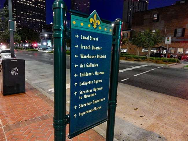 SEPT 14, 2015 - Sign on sidewalk pointing to attractions, French Quarter, Art Galleries, Streetcars on Poydras St, New Orleans, LA/photonews247.com