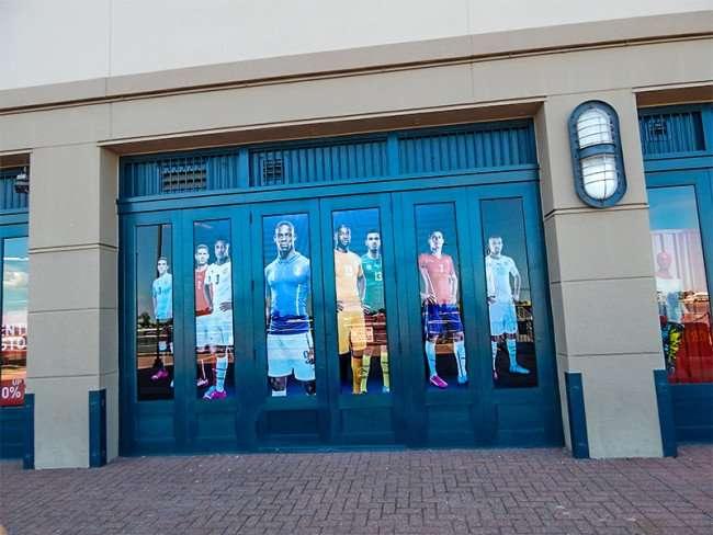 SEPT 14, 2015 - Sports figures on windows along New Orleans Riverwalk shopping center/photonews247.com