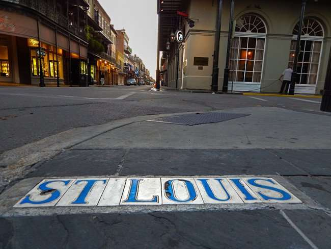 SEPT 14, 2015 - St Louis in blue lettering tile embedded on sidewalk in French Quarter, New Orleans, LA/photonews247.com