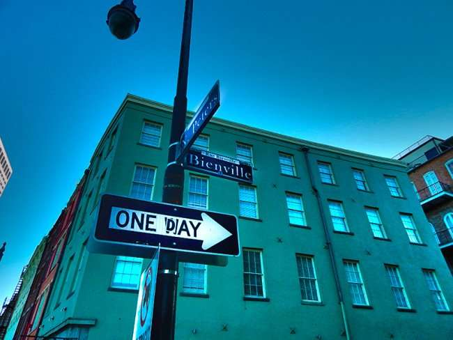 SEPT 13, 2015 - Street sign at corner of N Peters and Bienville with One Day sign pointing one way, New Orleans, LA/photonews247.com