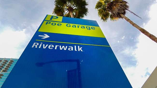 AUG 23, 2015 - Street sign pointing to Riverwalk and Poe Garage in Downtown Tampa, FL/photonews247.com