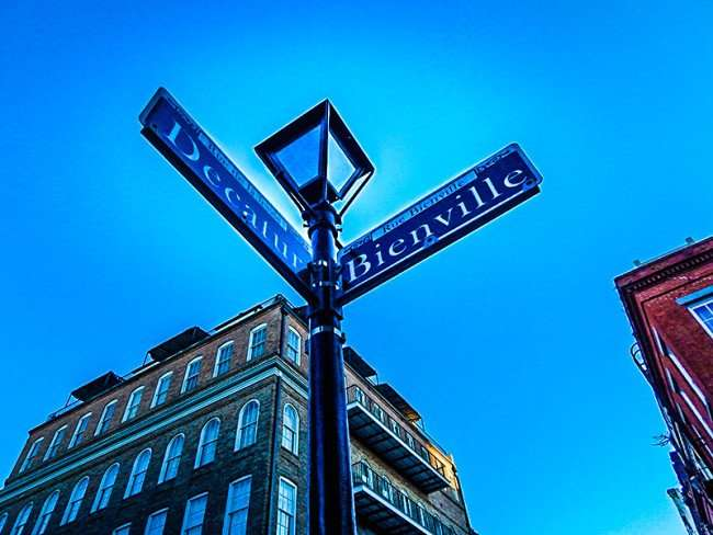 SEPT 13, 2015 - Street sign with lamp at corner of Decatur and Bienville Street in New Orleans/photonews247.com