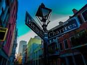 SEPT 13, 2015 - Street sign with lamp for corner of Bienville St and Chartres St, French Quarter, New Orleans/photonews247.com