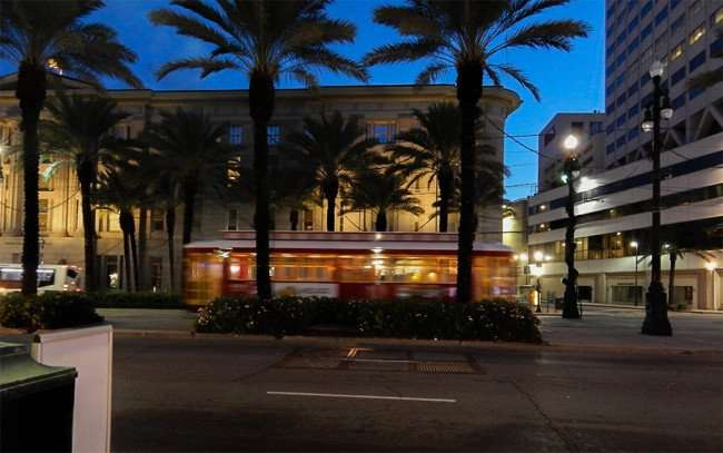 NOV 19, 2015 - Streetcar blurred at dawn traveling down Canal Street in New Orleans, LA/photonews247.com