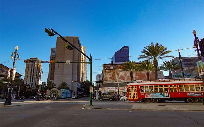 SEPT 13, 2015 - Streetcar on Canal Street in New Orleans with DoubleTree and Regions building in background/photonews247.com