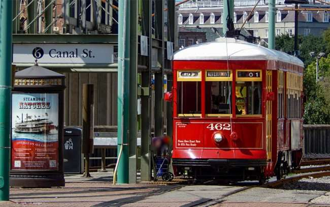 SEPT 14, 2015 - Streetcar 462 stops to pickup man at start of Canal Street at the riverfront in New Orleans, LA/photonews247.com