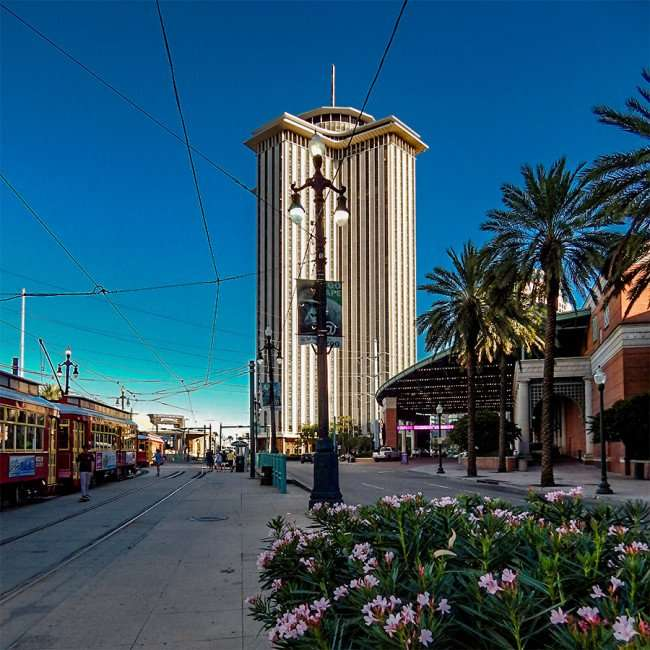 SEPT 13, 2015 - Streetcars on Canal St with view of former WTC and Harrahs, New Orleans, LA/photonews247.com