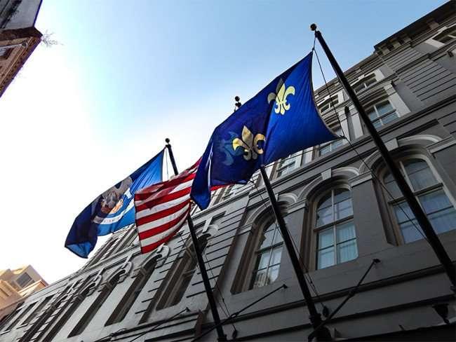 SETP 14, 2015 - Three flags flying on Pelham Hotel on Common Street in New Orleans, LA/photonews247.com