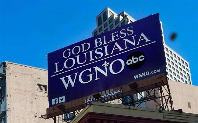 SEPT 13, 2015 - WGNO ABC says GOD BLESS LOUISIANA on billboard on Canal Street, New Orleans/photonews247.com
