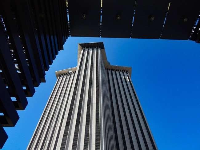 SEPT 14, 2015 - A view of the World Trade Center building from under the The Riverwalk entrance sign in New Orleans, LA/photonews247.com