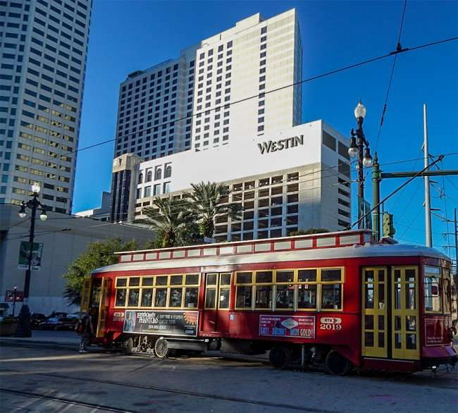 SEPT 13, 2015 - Westin New Orleans Canal Place with 2019 Canal streetcar in front/photonews247.com