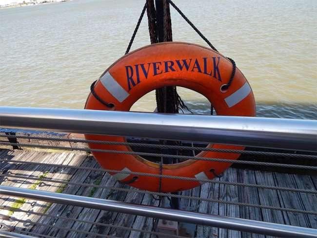 SEPT 14, 2015 - Orange circular life preserver along New Orleans Mississippi Riverwalk/photonews247.com