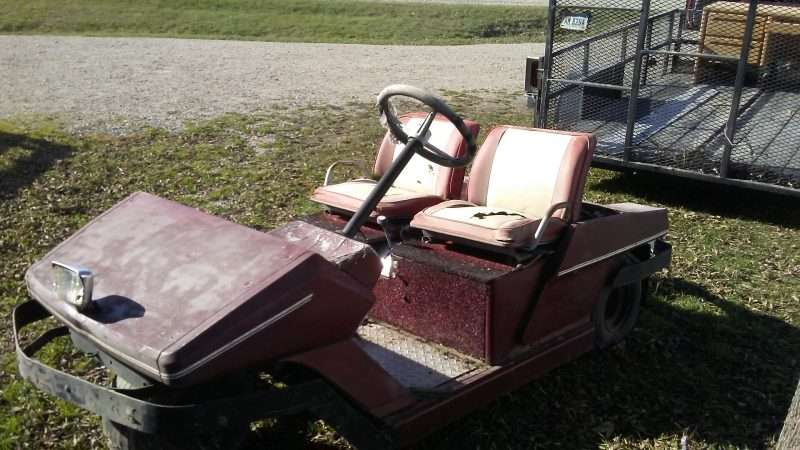 Old Cushman three wheel golf cart