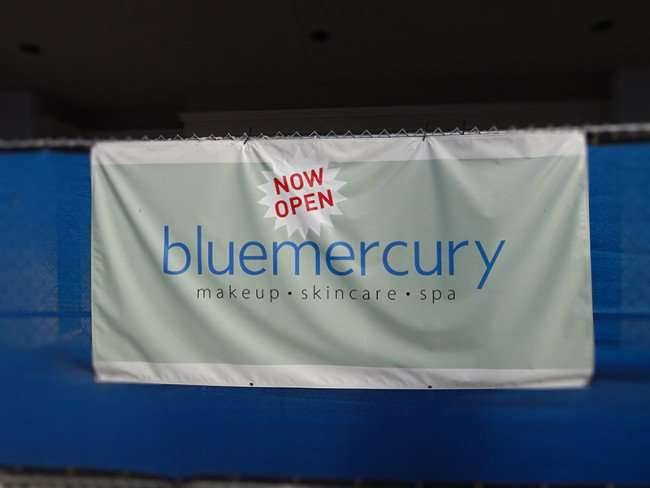 NOV 8, 2015 - Bluemercury Now Open sign at construction site along Swann Avenue, Tampa, FL