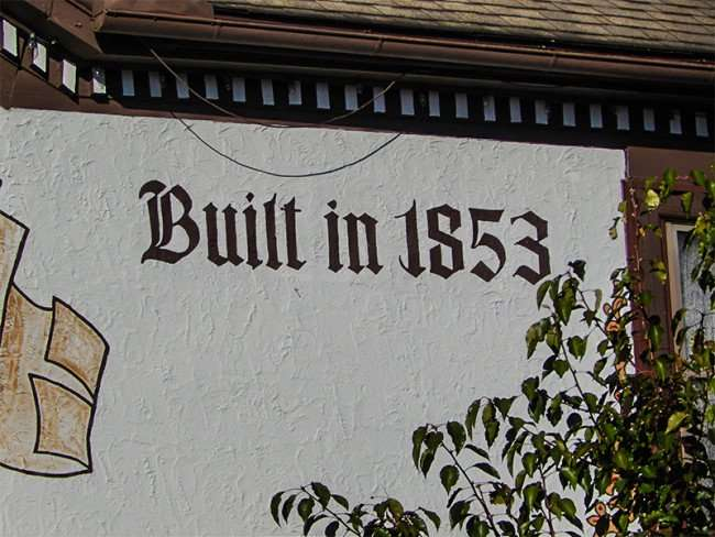 OCT 10, 2015 - Built in 1853 written on outside wall of New Glarus Hotel Restaurant in Wisconsin/photonews247.com