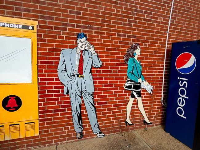 OCT 6, 2015 - Clark Kent next to phone booth image on outside wall on Superman Museum building, Metropolis, ILL/photonews247.com