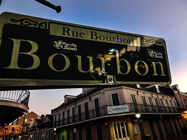 NOV 14, 2015 - Close up of Rue Bourbon Street street sign with River City Saints decals stickers in the French Quarter neighbohood in New Orleans, LA/photonews247.com
