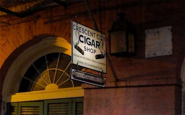 SEPT 14, 2015 - Crescent City Cigar Shop sign in front of building in the French Quarter/photonews247.com